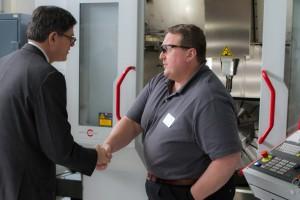 Treasury Secretary Jacob J. Lew (l) meets CCAM Machinist, Johnny Capps (r)